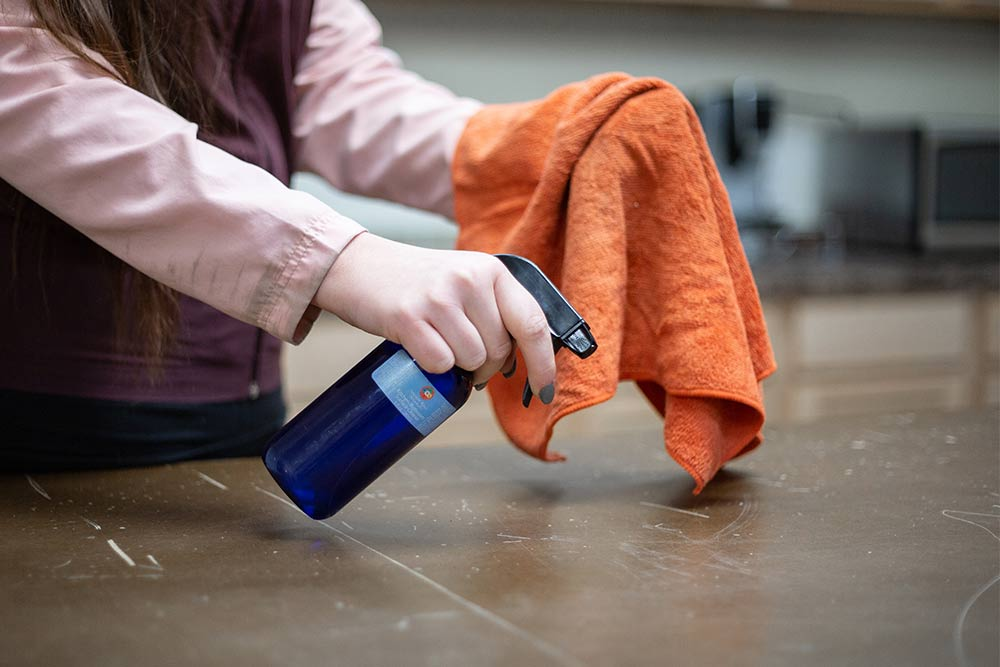 Hydrosol category with woman spraying Ancient Ways Botanicals Kitchen Cleaner