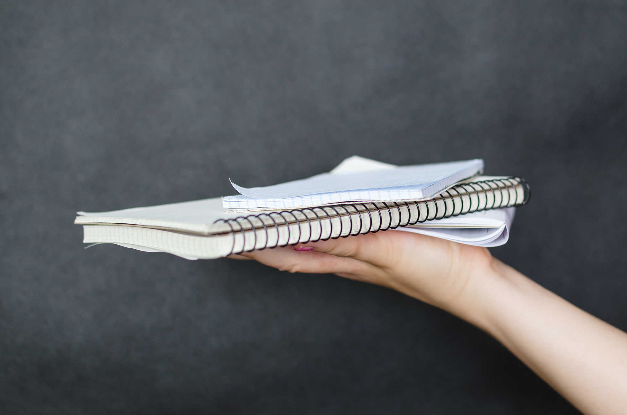 Articles and Essays page banner with hand holding written articles